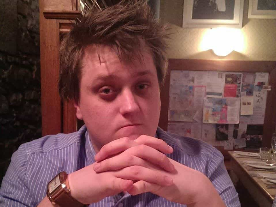 Meet The Team - John Collins sat with his hands together - Web Design SEO Company