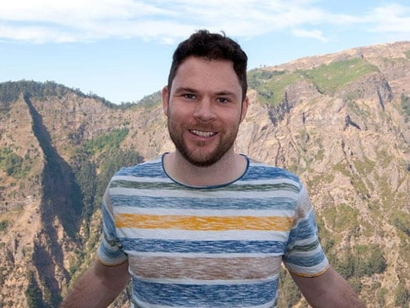 Meet The Team - Matt Barber stood with mountains and blue sky in the background - Web Design SEO Company