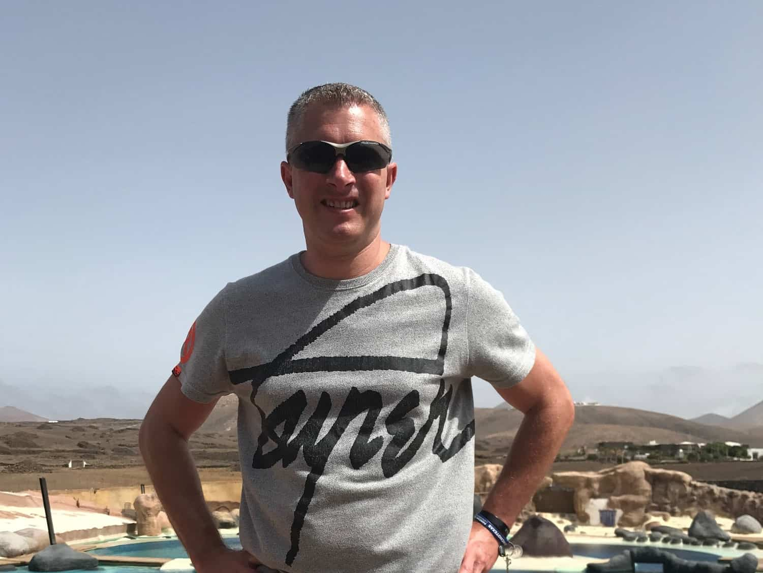 Meet the Team - Jason Crabtree stood up with blue sky and hills behind - Web-Design SEO Company